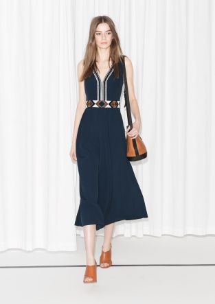 Opulent+ento-inspired+embroidery+embellishes+the+plunging+neckline+and+the+high-marked+waist+of+this+sleeveless+maxi+dress+crafted+from+billowing+viscose.
