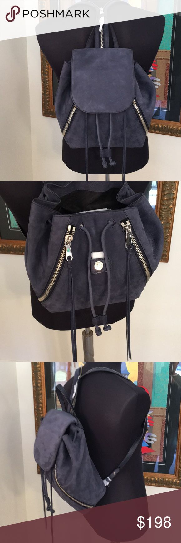 🆕REBECCA MINKOFF LARGE SUEDE BACKPACK 💯AUTH 🆕REBECCA MINKOFF LARGE SUEDE BACKPACK 💯AUTHENTIC. SO PRETTY AND STYLISH ALWAYS ON TREND. NEW WITH TAGS. IT HAS TWO OUTSIDE POCKETS. IT CAN BE ONE STRAP OF UNZIPPED TO BE TWO. THE COLOR IS CALLED MOON. I WOULD SAY IT IS A GRAYISH BLUE. WHEN FULLY OPENED IT IS 15 INCHES WIDE BY 12 INCHES TALL. SUCH A LOVELY SODT SUEDE BAG. THE COLOR VARIATION MAKES IT EVEN LOVELIER! Rebecca Minkoff Bags Backpacks