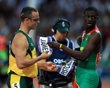 In a gesture of camaraderie and respect, Kirani James (R) of Grenada exchanges bibs with Oscar Pistorius (L) of South Africa after the Men's 400m semifinal on Day 9 of the London 2012 Olympic Games at the Olympic Stadium on August 5, 2012 in London, England