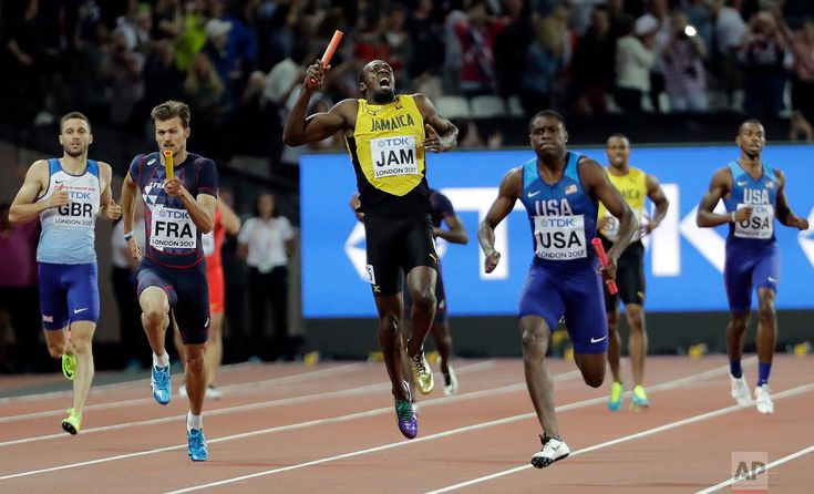 Britain Athletics Worlds Jamaica's Usain Bolt, center, pulls up injured in the final of the Men's 4x100m relay during the World Athletics Championships in London on Aug. 12, 2017. At right is United States' Christian Coleman. (AP Photo/David J. Phillip)