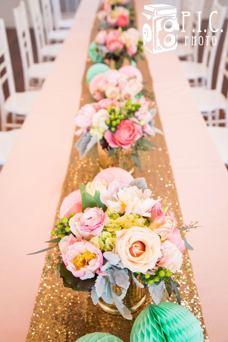 Sparkle and Floral Mint, Pink, Peach and Gold Glitter First Birthday by House of Creative Designs. Garden Rose flowers, Gold Glitter Sequins table runner, Peach tablecloth and mint and pink honeycomb pom poms.