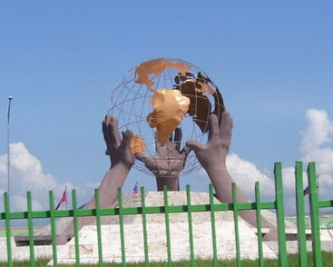 Port-au-Prince, Haiti: Three Hands Statue at airport.