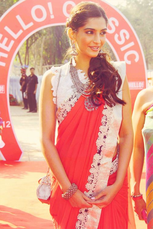 sonam kapoor - I love how shes made a typical saree so chic and fresh and cool!