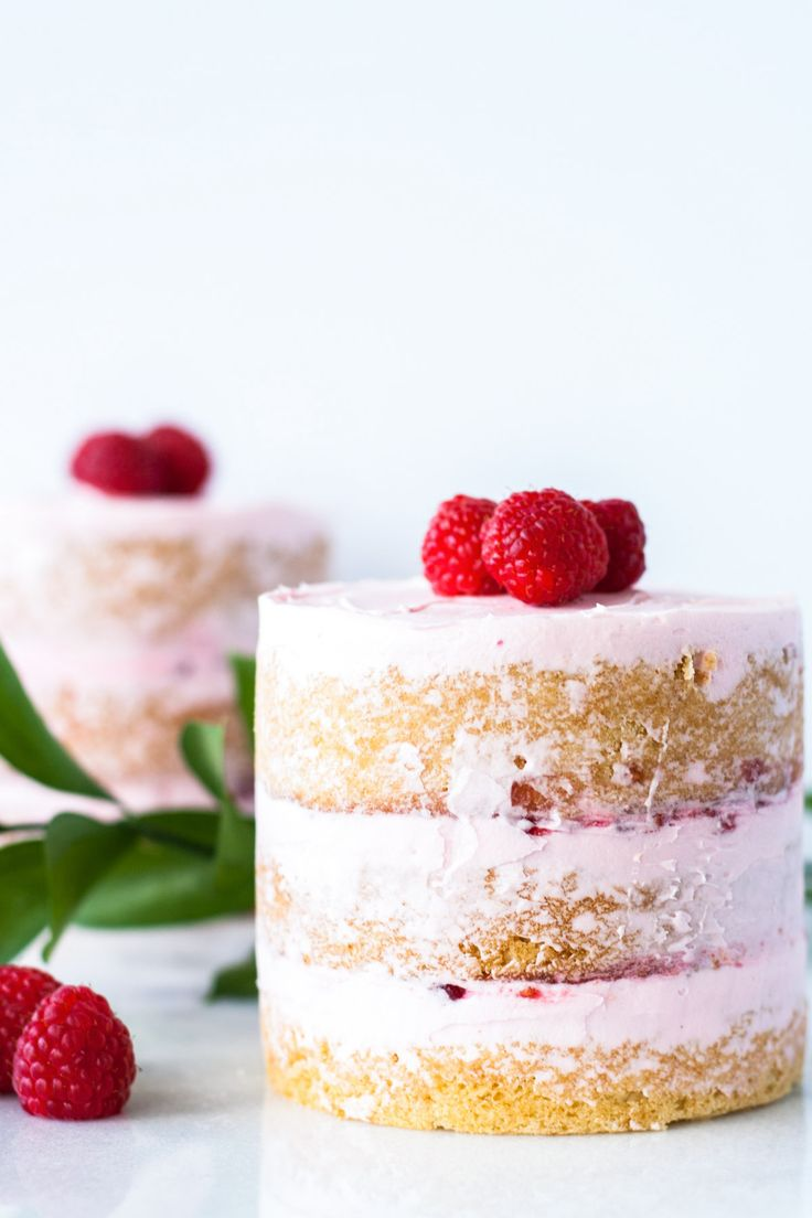Buttery cake with a creamy vanilla frosting layered with raspberry jam.