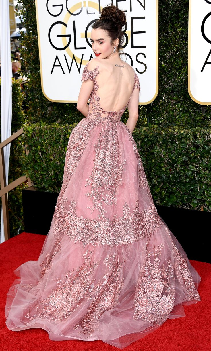 LILY COLLINS continues her style streak in a rose-pink lace Zuhair Murad Couture dress with an open back and Harry Winston jewelery.