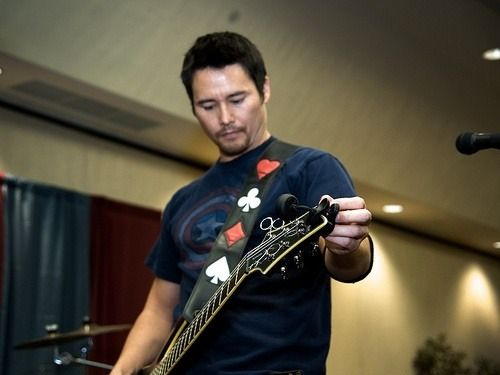 Johnny Yong Bosch with his guitar