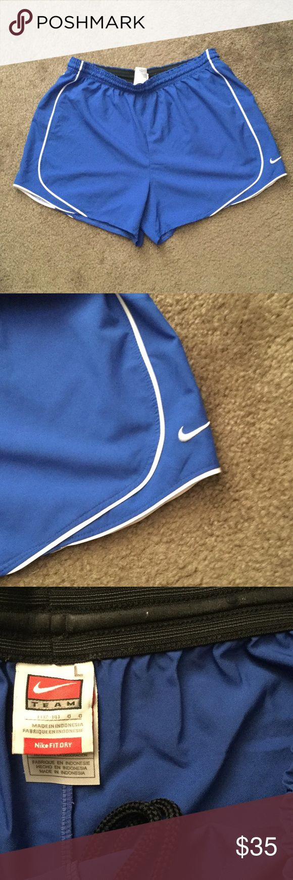 Nike soccer shorts Royal blue and white. Excellent condition. Drawstring in order to help them stay put! Nike Shorts