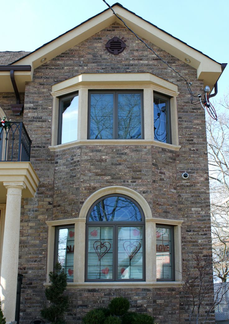 Cast stone window trim looks amazing over cultured stone or brick finishes  Surrounds and
