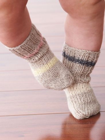 Free Pattern - These ribbed socks for baby are stretchy enough to stay up all...