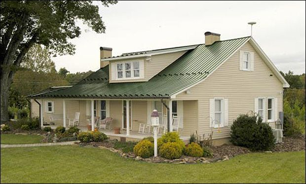 house colors with green metal roof