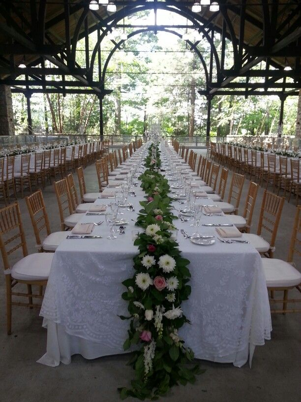 Beautiful Wedding table decorations in the Pavilion at Mohonk Mountain House. Designed by Colonial Flower Shop, New Paltz, New York.