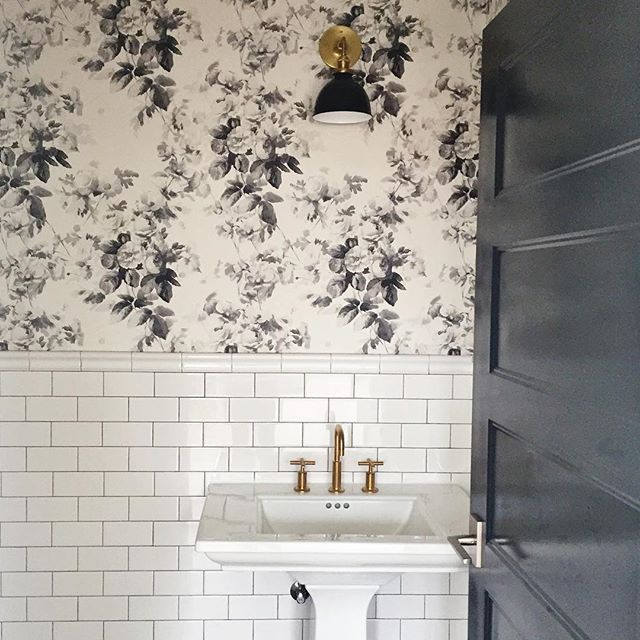 subway tile and floral wallpaper, black and white bathroom