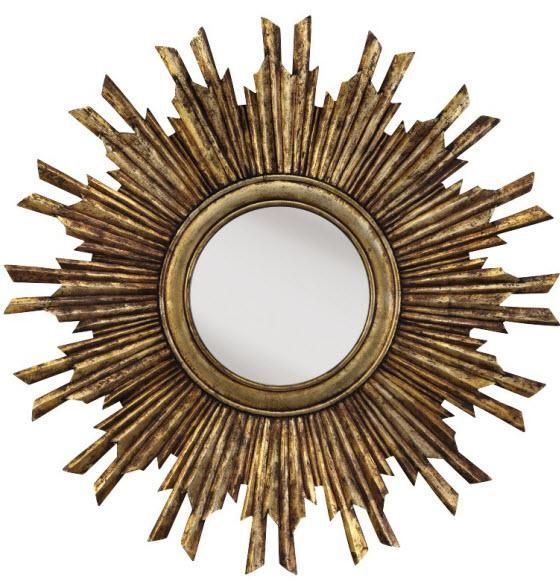 Pretty in gold This wall mirror will make for the perfect