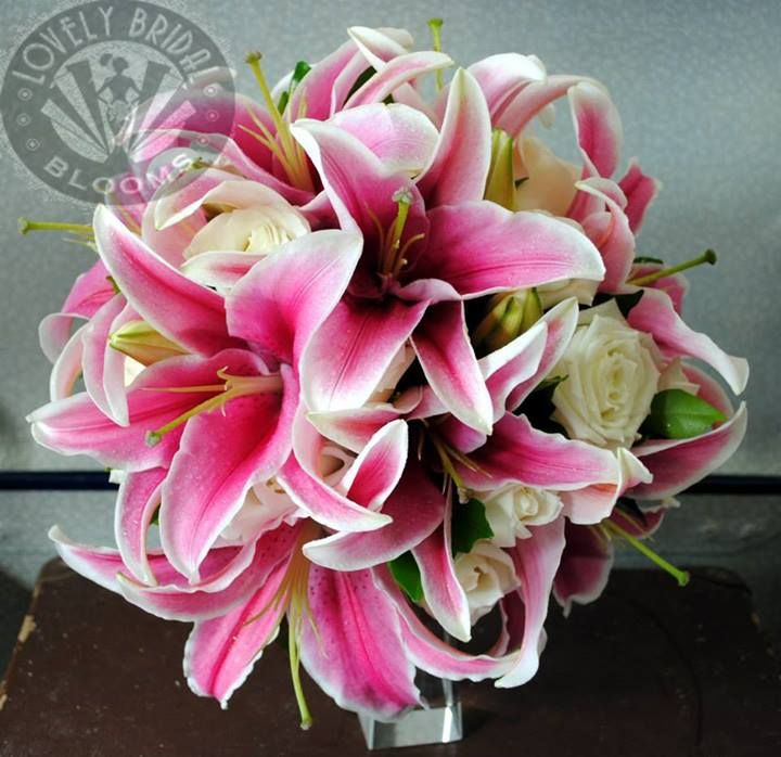 bouquet of pink oriental lilys and white roses, created by lovely bridal blooms