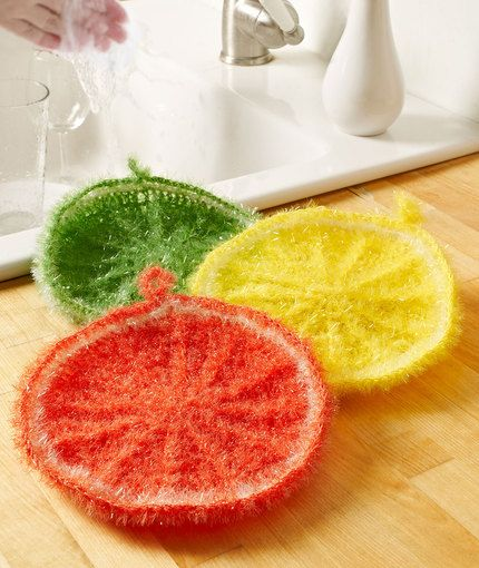 Splash of Citrus Scrubby Free Crochet Pattern -- You'll love these citrus rounds for washing dishes or scrubbing the sink! This textured yarn has a sparkle effect, is easy to crochet with and can be thrown in the washing machine to keep it fresh.