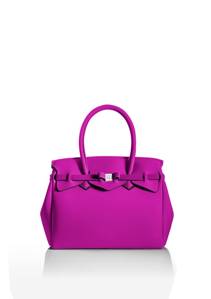 This iconic tote is available in over 30 colours to suit every style!   Light and versatile, the Miss bag is our collection's best seller. The covetable tote comes with a bow and interchangeable strap to make the bag customisable.  Size  340 x 290 x 180 mm  380g  Made in Italy  Vegan Friendly  Made from Poly-Lycra Fabric   Hot Pink