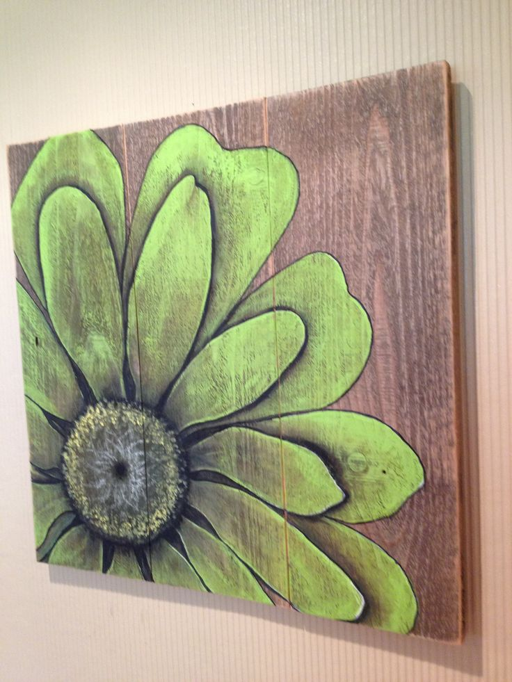 Green flower painted in acrylics on barn board