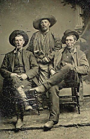 Tough Customers of the Old West  Are they (L to R) Frank James, Fletch Taylor, and Jesse James  The hombre standing in the center has a Whitney Navy conversion revolver tucked in his vest