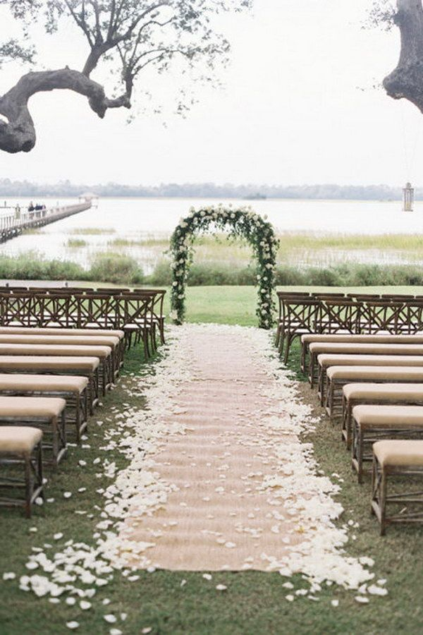 "Classic Floral Arch with Petal Burlap Wedding Aisle Runner  and Linen Upholstered Wooden Benches A-HA!!! I'm going to ""pin"" down the sides with galvanized steel landscape cloth anchors! Don't forget the hammer!"