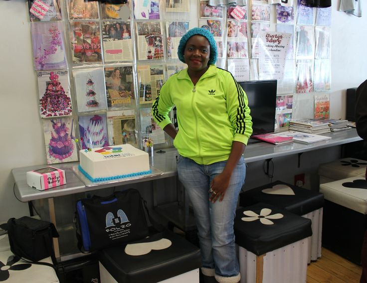 The cake decorator at Charly's Bakery also happens to be a Shona interpreter for InterTel.