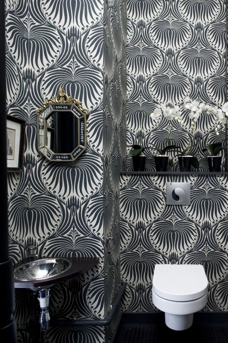 Inspiration from Bathrooms.com: Choose a wallpaper that just stops short of over-powering for a bathroom with wow factor. Monotones work well and highlight the shapes of your sanitaryware. Lotus wallpaper by Farrow & Ball. #bathrooms #bathroomwalls #bathroomtiles #bathroomideas