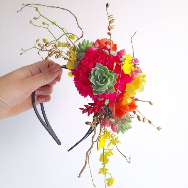 Fresh floral fascinator for a hens party. Gold accents with hot pink, teal, red and yellow interesting textural flowers.