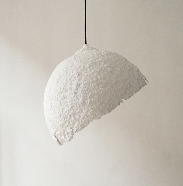 "**Pendant lamp ""Globe blanco"" made from paper pulp** The Form of the lamp refers to the shape of the Earth. Its ""nucleus"" the source of light, brings it to life. When enabled, we'll see a glowing..."