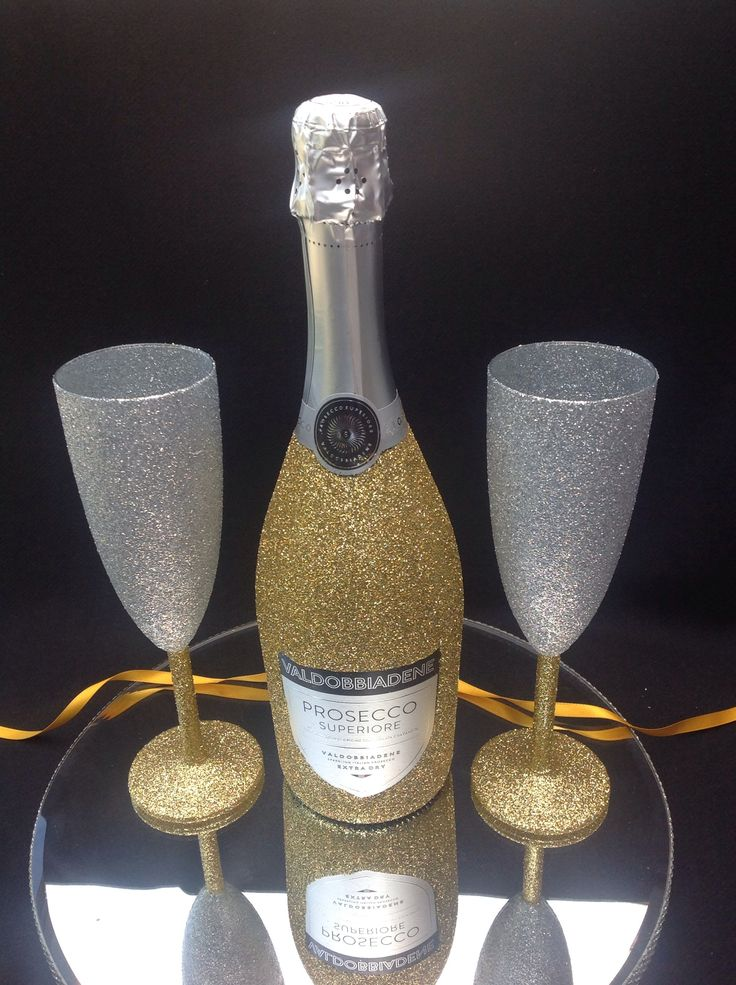 2 glasses and bottle of prosecco gift wrapped and wine charms £29.99 set. Choice of colours.