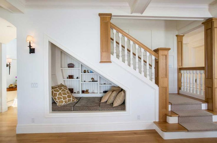 Charming Reading Nook Under Stairs.