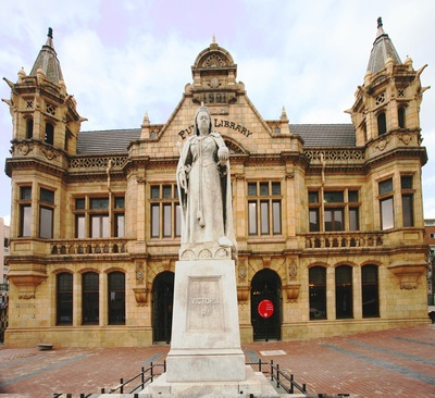 The majestic Sicilian marble statue of Queen Victoria, which keeps watch over the Market Square, was erected and unveiled in 1903. Visitors are invited to browse around inside the Library. Port Elizabeth, South Africa