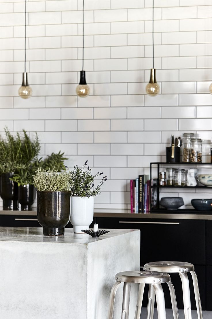 Spice up your kitchen décor with fresh herbs. Go for great-tasting herbs like basil, rosemary and thyme and place them in ceramic pots with a beautiful play of colour. Not only will they add layers of taste to your dishes, they'll revive your kitchen's décor with a warm and personal appeal.