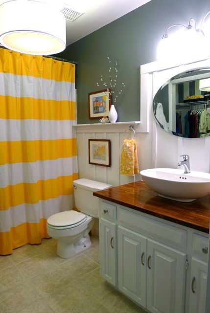 So bright and happy!  Love the yellow towels (World Market?) and striped shower curtain. (West Elm?)