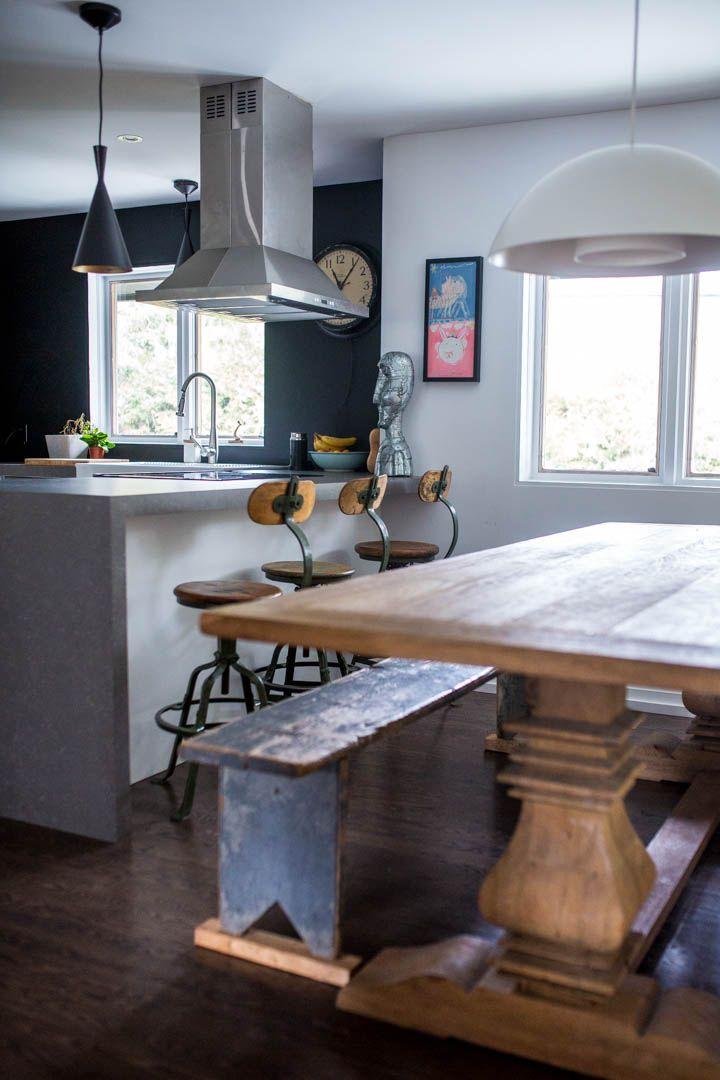 A vintage modern home in Rosemère, Québec. Restoration Hardware style table, vintage bar stools & concrete countertop.