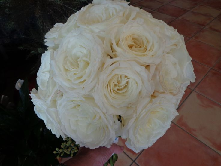 bridal bouquet of white garden roses hand tied floral designs by china rose florist