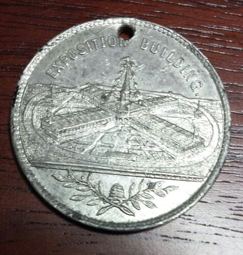 Commemorative medal or badge issued for the 1881 International Cotton Exposition held at Oglethorpe Park in Atlanta. From the J. Fred Rodriguez Atlanta Collection.