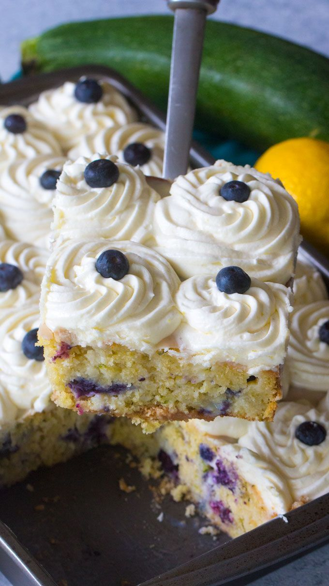 Blueberry Zucchini Poke Cake is so tender, moist and delicious. Made with zucchini, olive oil and lots of fresh lemon, this cake is just amazing!