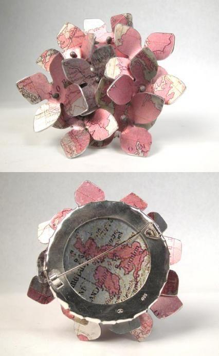 """Lynn Kelly: Hydrangea brooch """"British Colony"""" Stg silver, aluminium printed with maps, 2012,"""