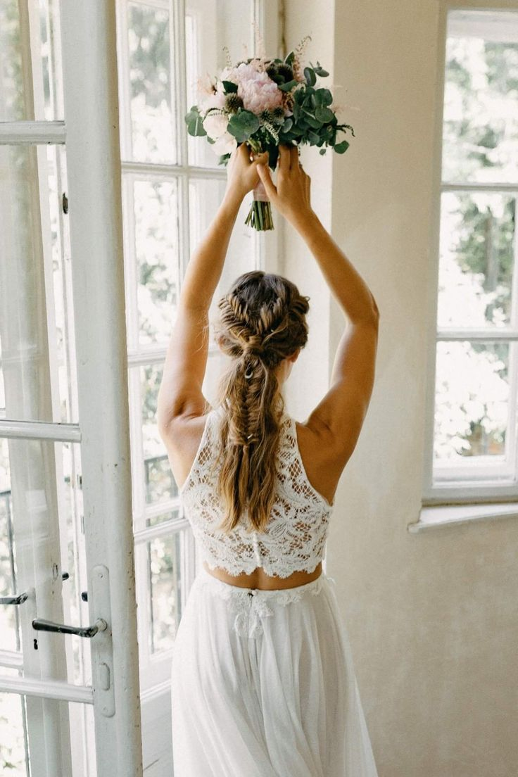 Timea Hadnagy is wearing her custom made French lace top and cotton tulle skirt / Nora Sarman Bridal / photo Botond Wertan