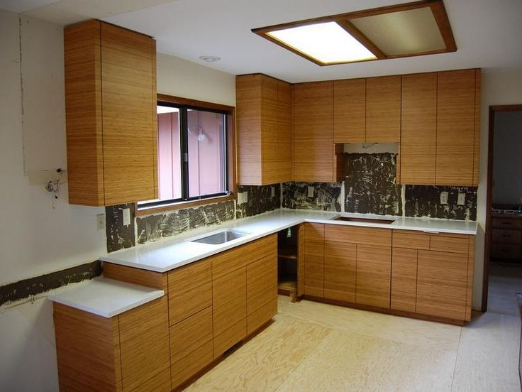 bamboo kitchen cabinets design with clean and empty kitchen