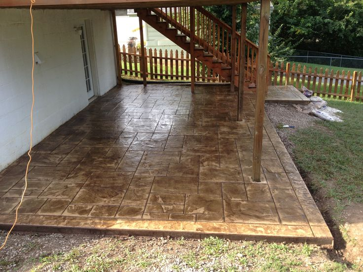 stamped concrete patio under deck backyard ideas