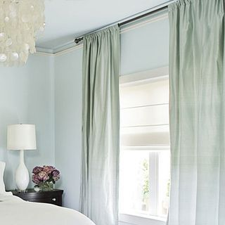 Hang Drapes High And Wide To Make Your Room And Windows