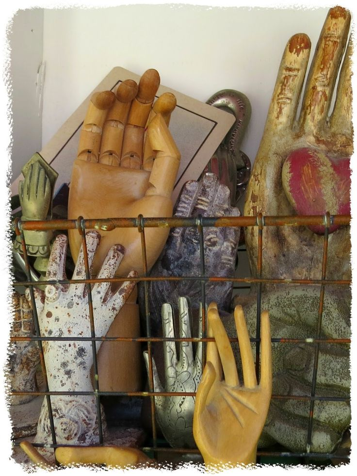 Art and Sand: Carol's collection of hands, and one is holding a heart.  Love this arrangement.