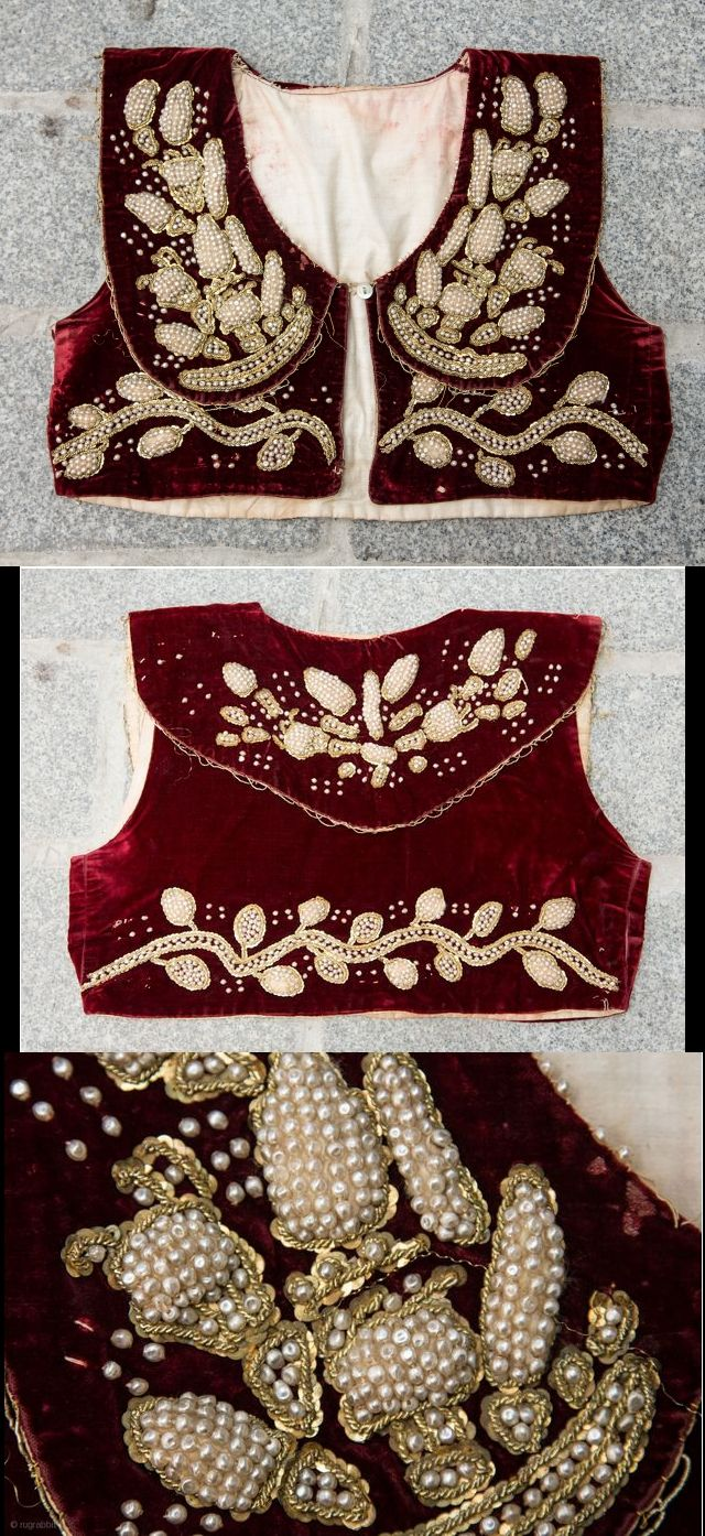Red velvet vest for women. Heavily embroidered with pearls and metallic thread. From Albania, late-Ottoman era, early 20th century.