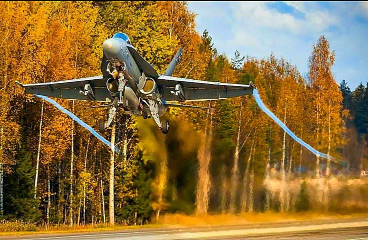 A great shot of an F-18C Hornet taking off from a road in Europe.