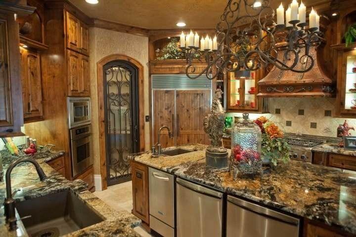 ornate metalwork in old world gourmet kitchen #tuscankitchens