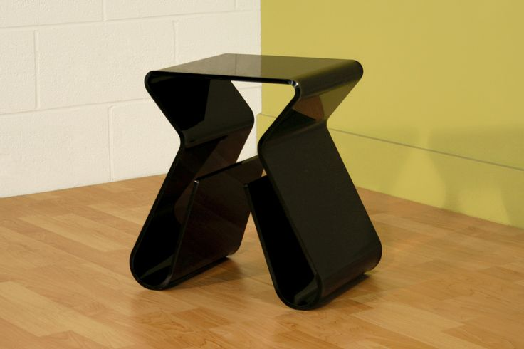 deep black glass table with such gorgeous tiny ribbon shape and there place to keep newspapers in both legs and fit to be placed corner of rooms