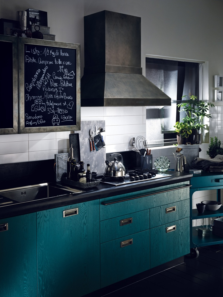 """The steel frame doors of the wall units can be customised afresh every day thanks to the """"blackboard slate effect"""" surfaces 