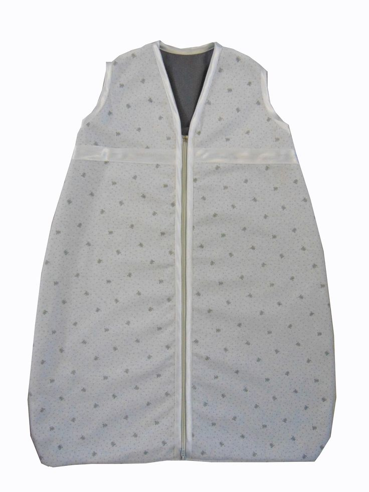 Unisex, little grey bears, design, baby sleeping bag, for ages 0-36 mnths. R350. Can be made with white, yellow, pink or blue trim to match nursery. Two layers of soft cotton with cosy batting between. Soft satin trim to neck, arms and zip edge. Central zip from bottom to top for ease of night time changes.
