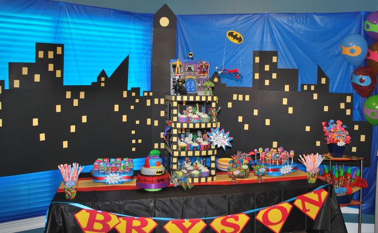 Superhero backdrop blue tablecloth from DT with black and yellow poster board to make a superhero city scene.