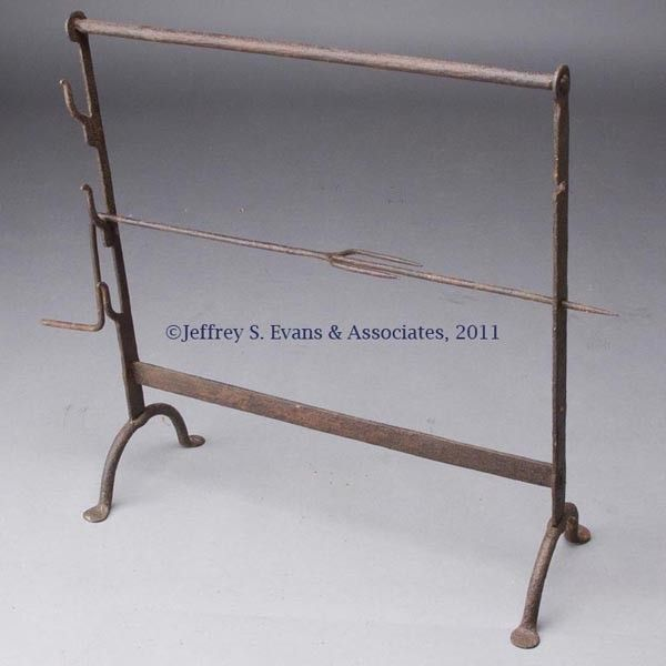 "WROUGHT-IRON ADJUSTABLE SPIT, three heights, with penny feet. 18th or 19th century. 25 3/8"" X 23""."